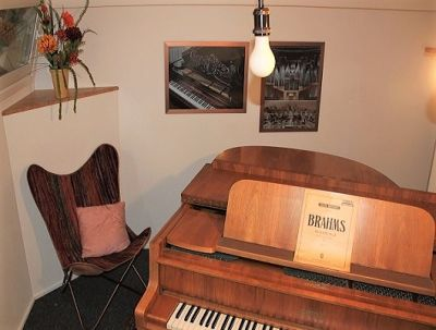 Practise room with grand piano, soundproofed, to be used over 24 hours.