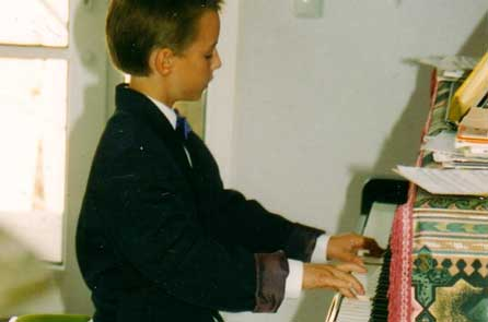 A young boy practicing the piano