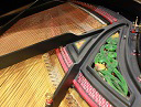 Interesting and rare decoration of the cast frame of an old Ibach grand piano