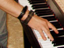 The hand which plays two keys as part of the tuning and adjusting process